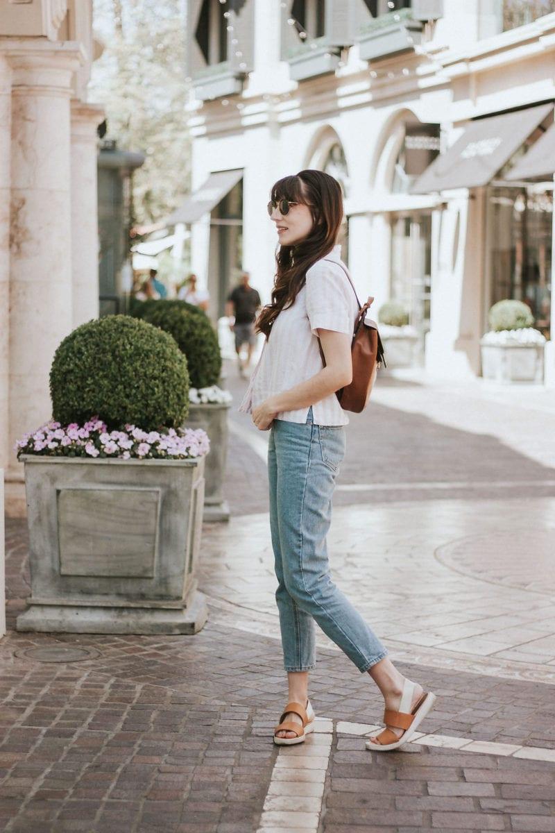 Minimalist Fashion Blogger with stylish backpack bag