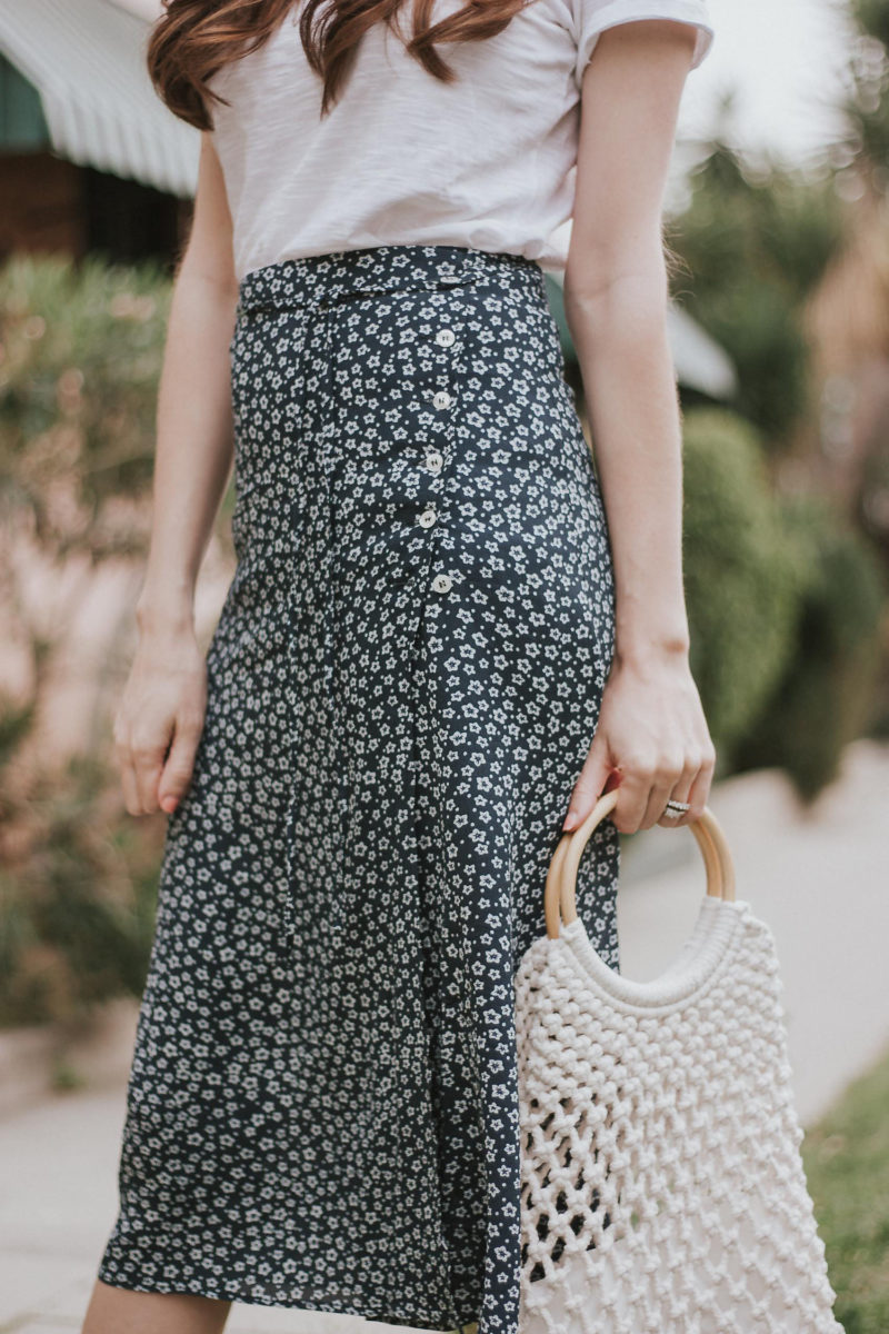 Rouje blue floral midi skirt with side buttons and ring handle bag