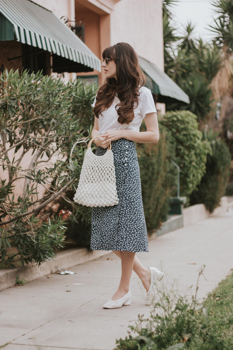 Floral midi skirt with white tee and white accessories