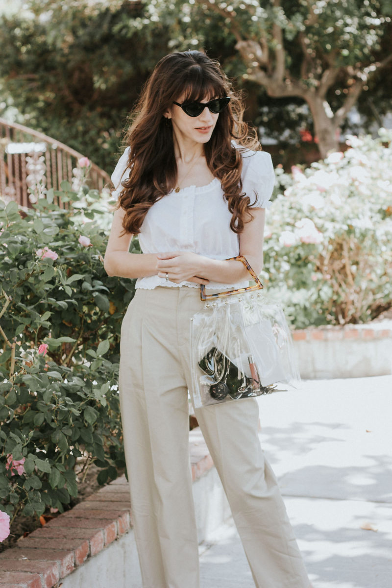 French Style White Cropped Top with Tan Wide Leg Pants and Clear Handbag