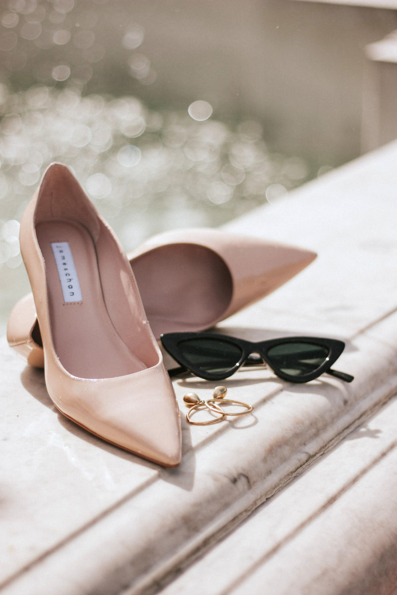 Nude patent leather mid heels from James Chan and slim cat eye sunglasses
