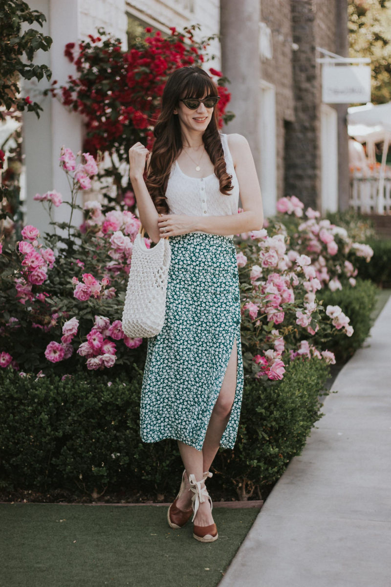 Los Angeles Fashion Blogger wearing a green floral midi skirt, button tank, soludos espadrilles and net bag.