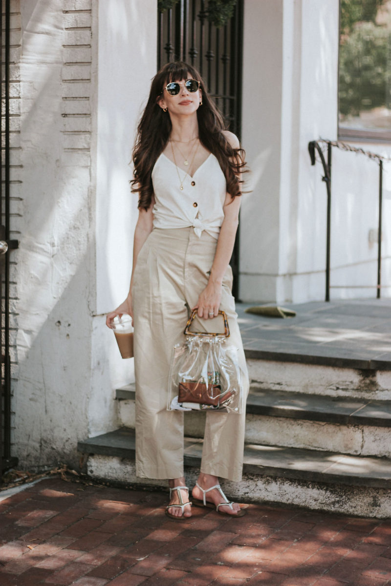 Philly Fashion Blogger with Clear PVC bag, wide leg trousers and tie front linen top with buttons