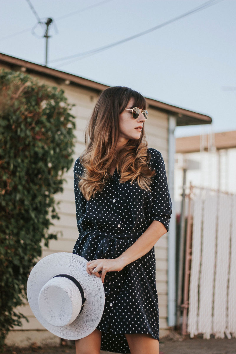 Minimalist style blogger wearing Everlane shirtdress with white straw hat