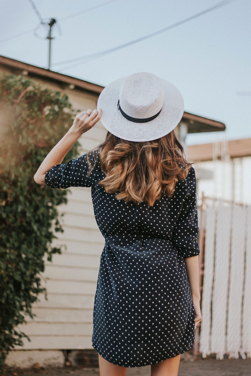 Balayage long brown hair with Kin the Label straw hat and Everlane Dress