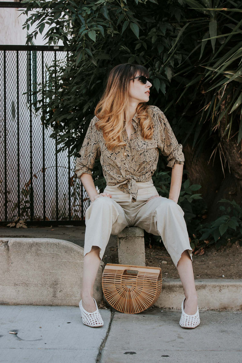Style Blogger wearing Outfit from thredUP, Silk Equipment Blouse, Cult Gaia Bag