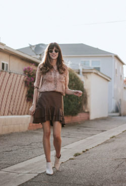 Los Angeles Fashion Blogger wearing top from ThredUP and faux leather skirt