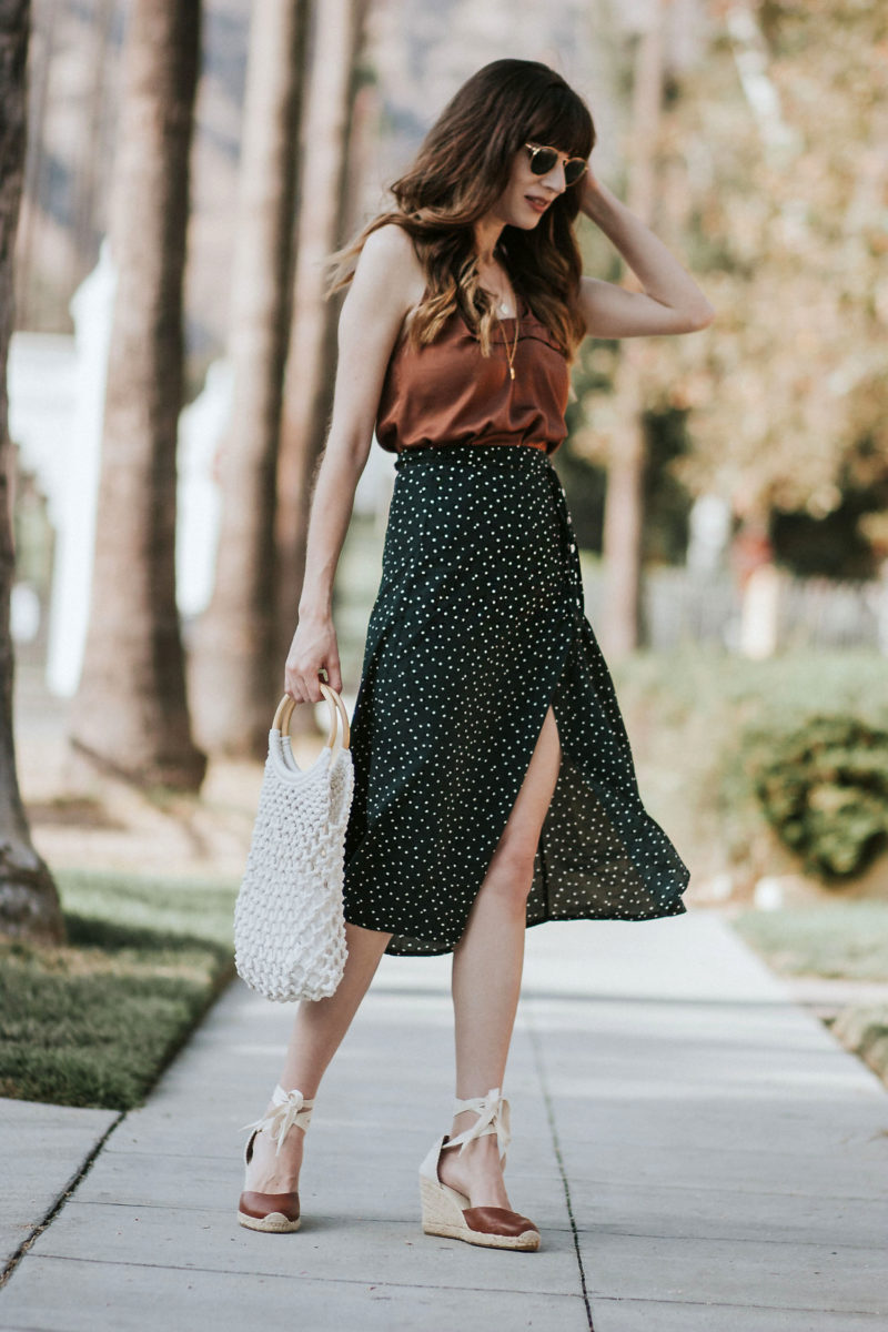 Green dot wrap skirt with brown satin cami and net bag