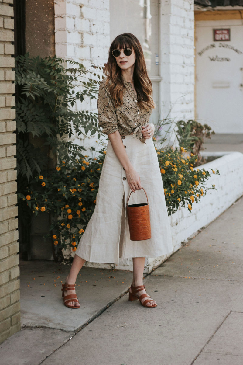 Los Angeles Fashion Blogger wearing Reformation Skirt and Equipment Blouse from ThredUP, Marais USA Sandals and Bucket bag
