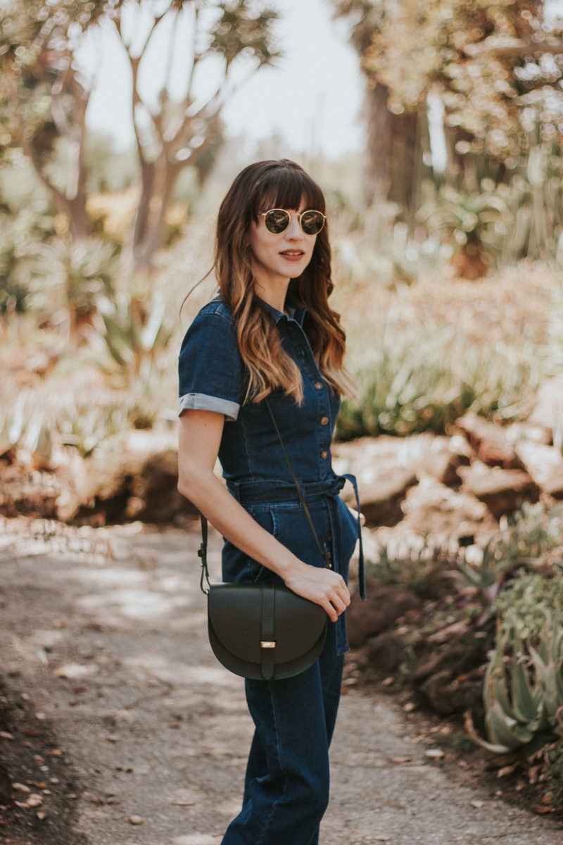 Sezane crossbody bag and denim jumpsuit at Huntington Gardens
