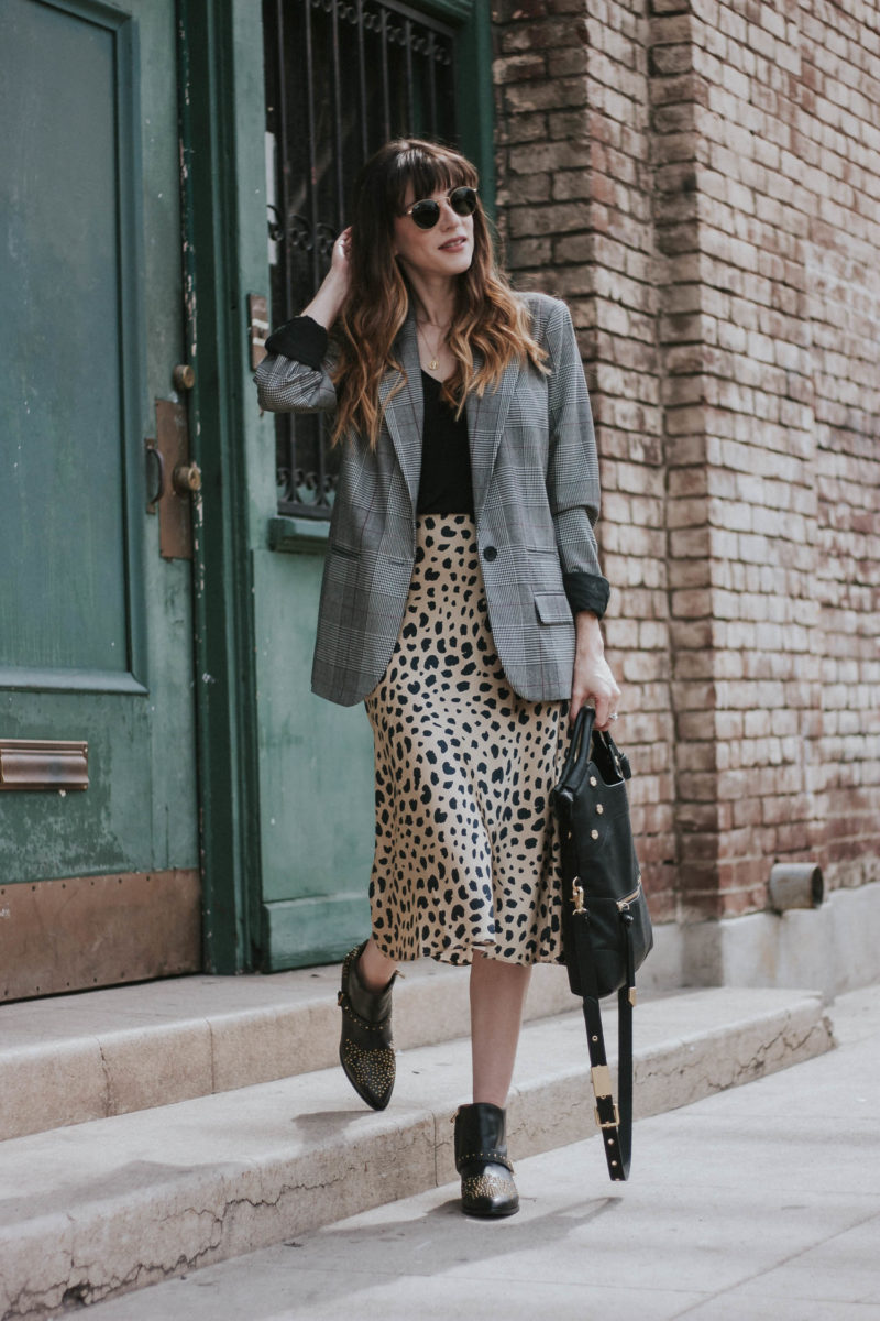 Mixed print outfit with plaid print blazer, leopard print skirt and Chloe dupe studded booties