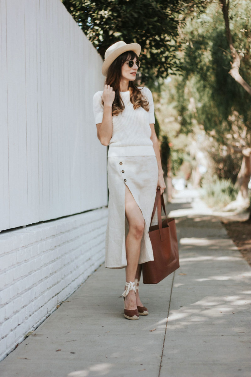 Los Angeles Style Blogger wearing Reformation Skirt, & Other Stories knit and Everlane Tote bag