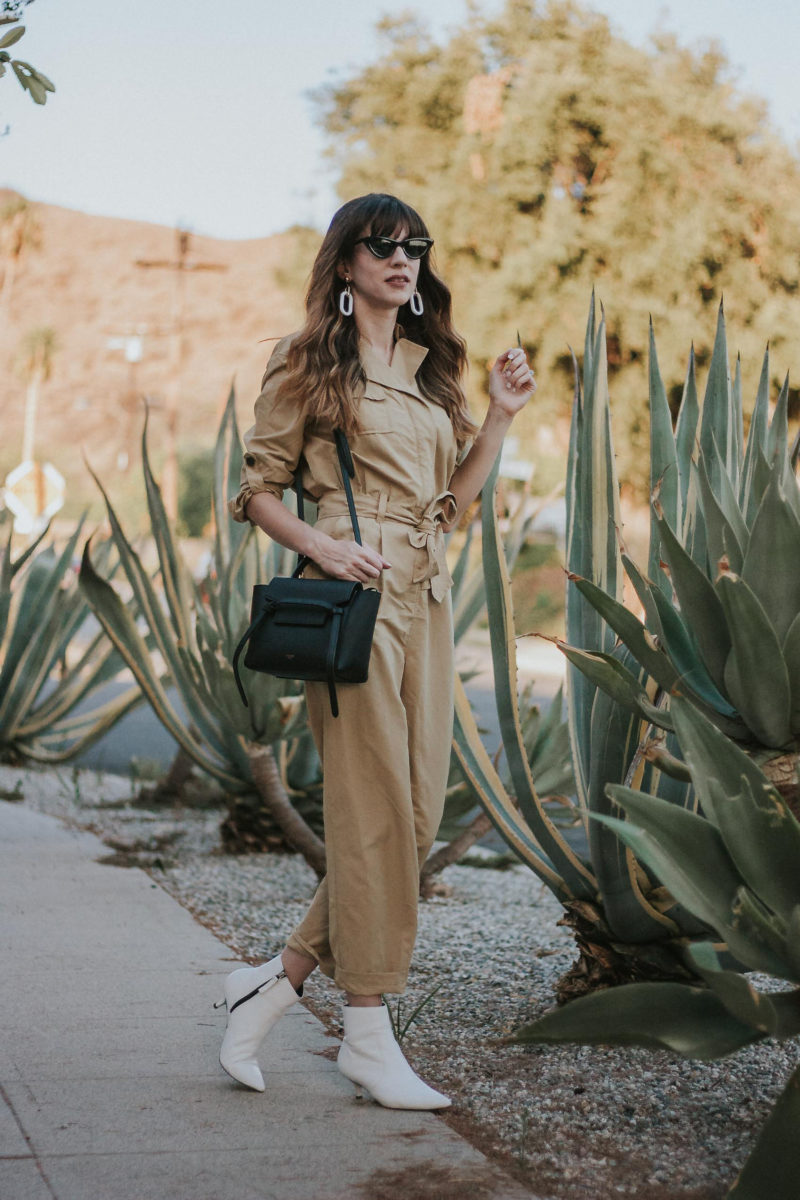 Tan jumpsuit with white booties and Celine Belt Bag