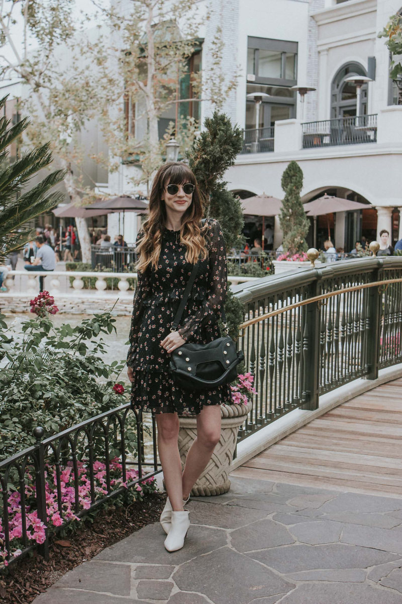 White booties with a fall floral dress and Foley and Corinna bag