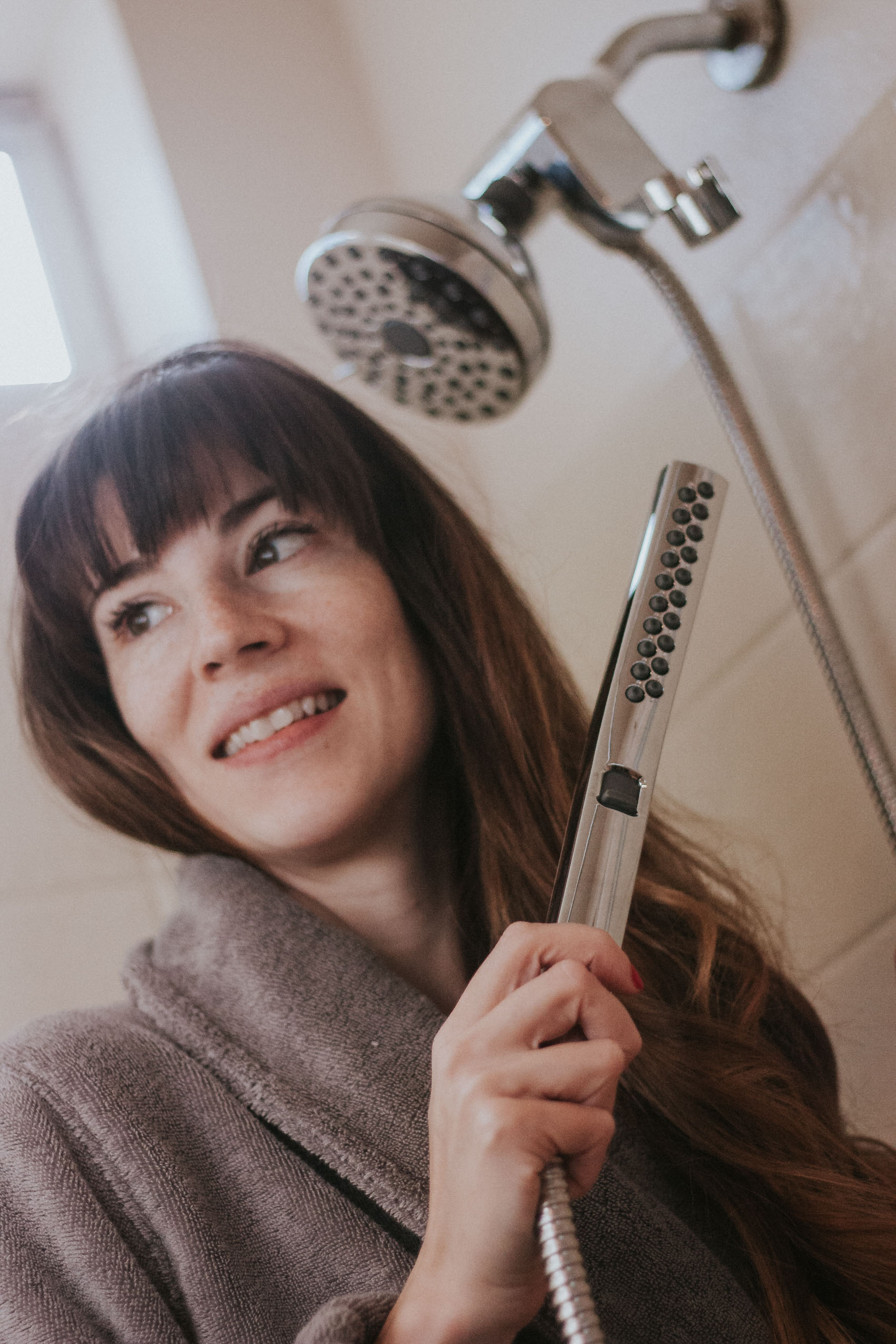 Fashion Blogger with WaterPik Hair Wand Spa System Shower Head