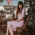 Los Angeles Blogger at a French Cafe wearing Purple Polka Dot Dress