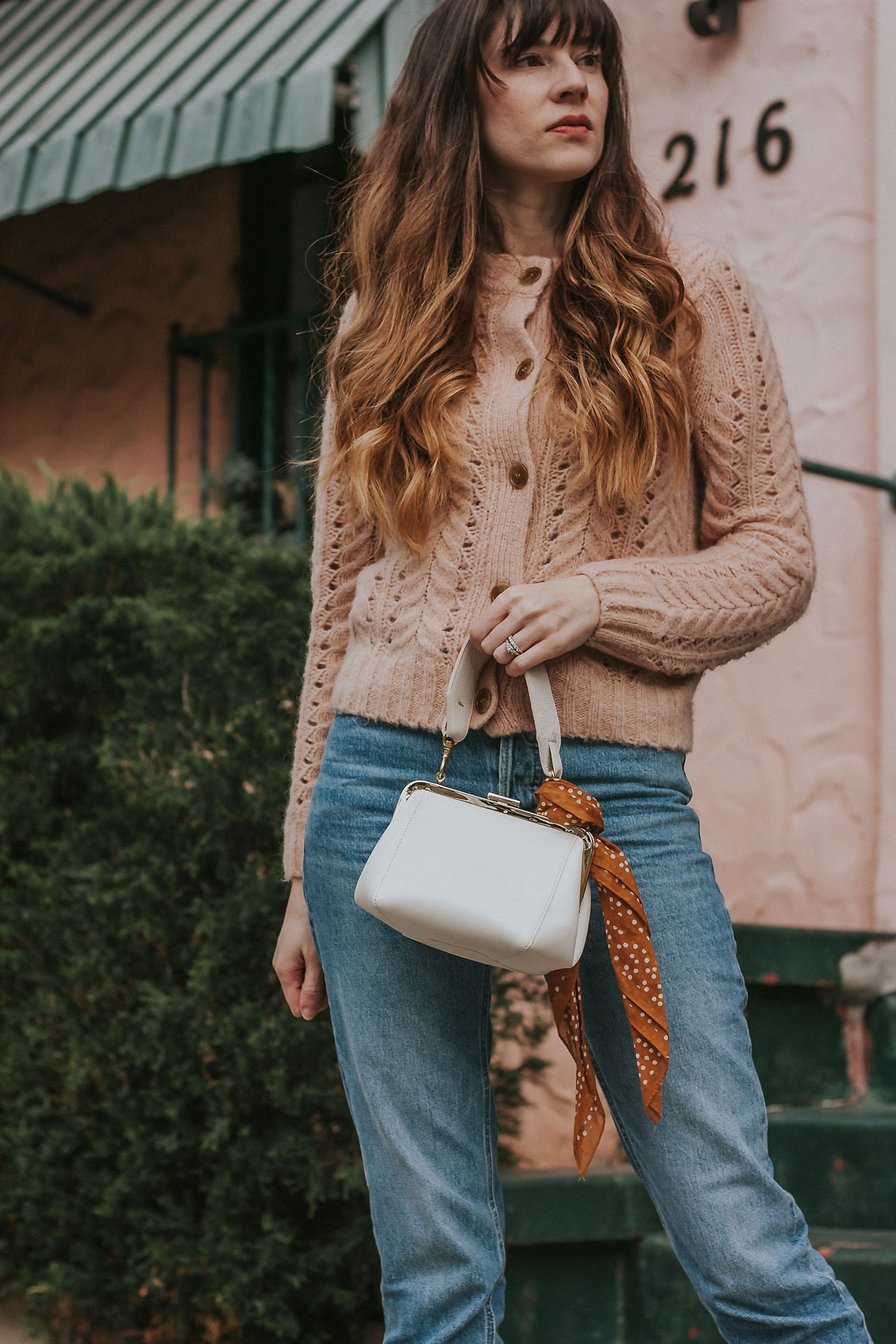 Los Angeles Fashion Blogger showing how to style a scarf on a bag