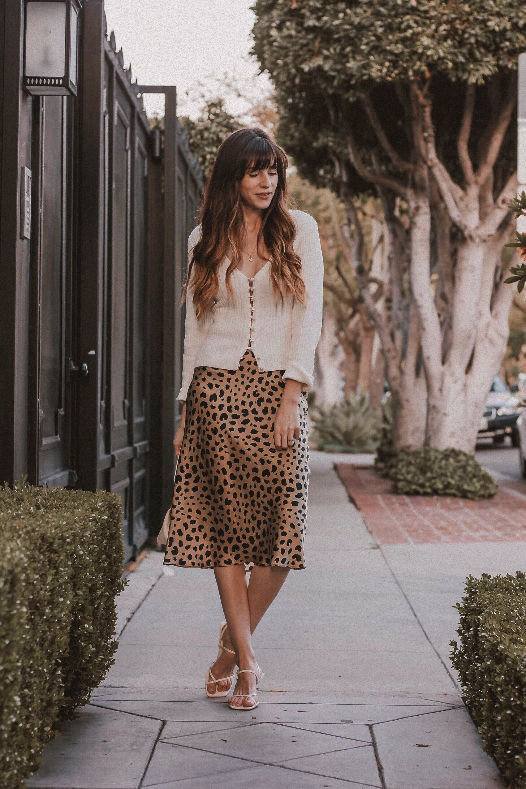 Los Angeles Fashion Blogger wearing Realisation Par Leopard Skirt, Musier Paris Sweater, and Zara heels