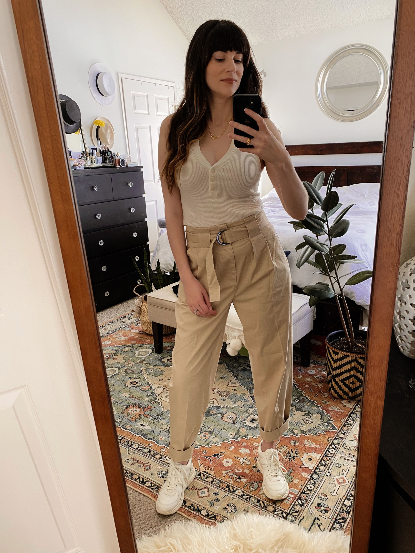 Banana Republic Pleated Pants with Naadam Tank and Everlane Sneakers