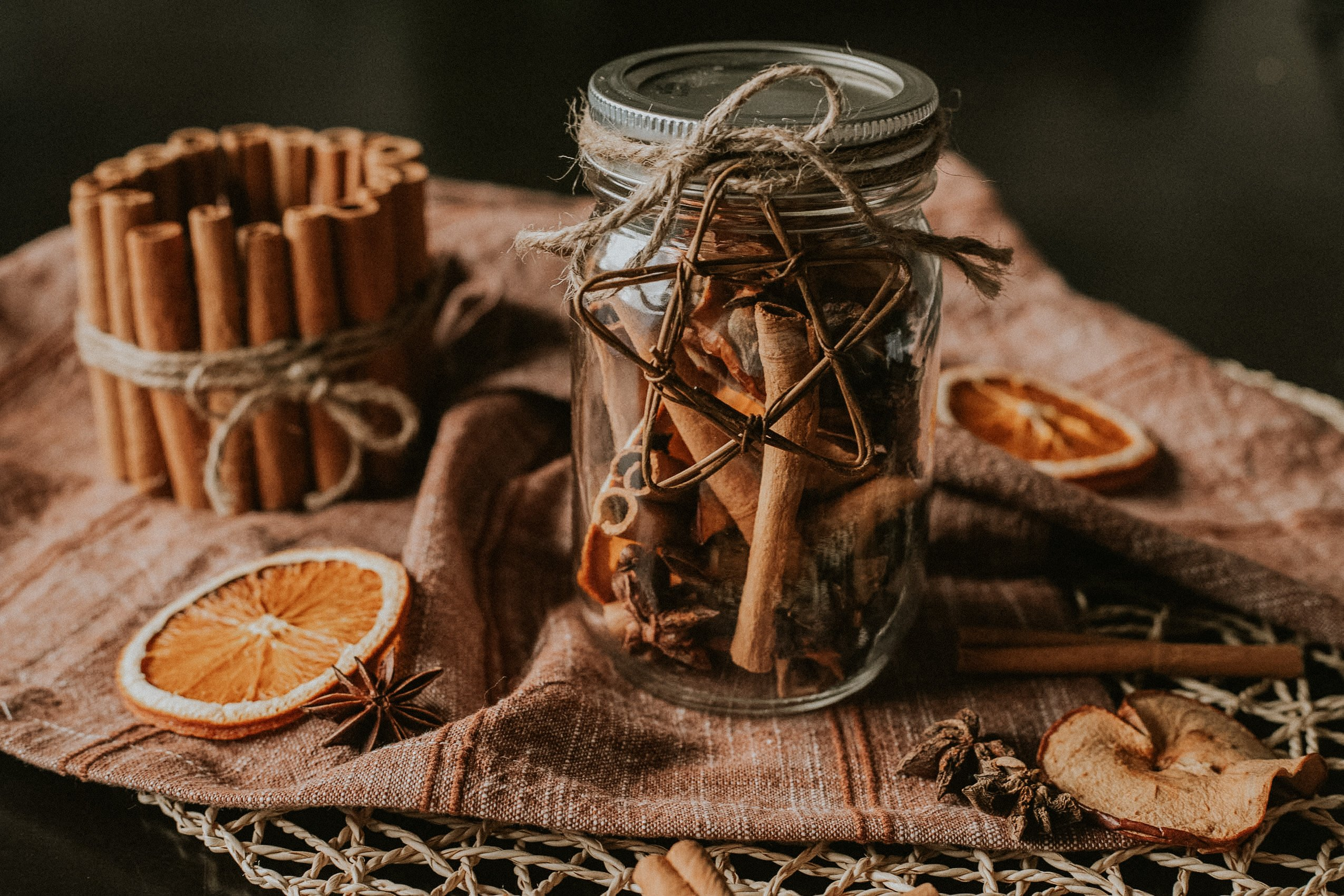 DIY Christmas Stovetop Potpourri with dried apples, oranges, cinnamon sticks, cloves, and star anise