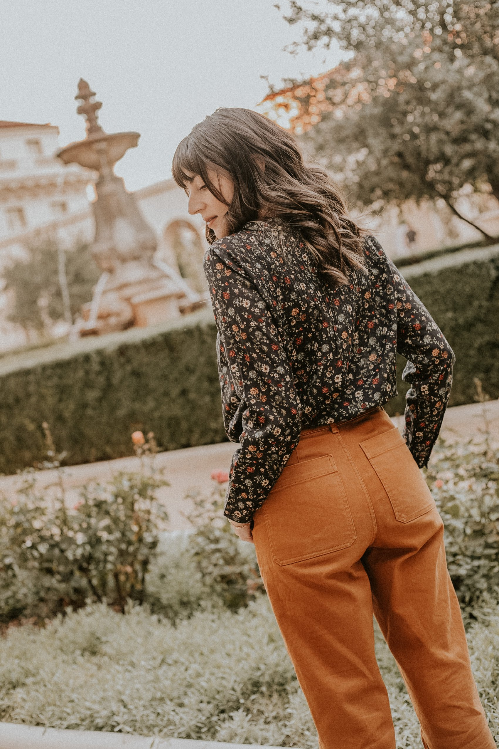 Everlane Straight Leg Pants with dark floral print top from Doen
