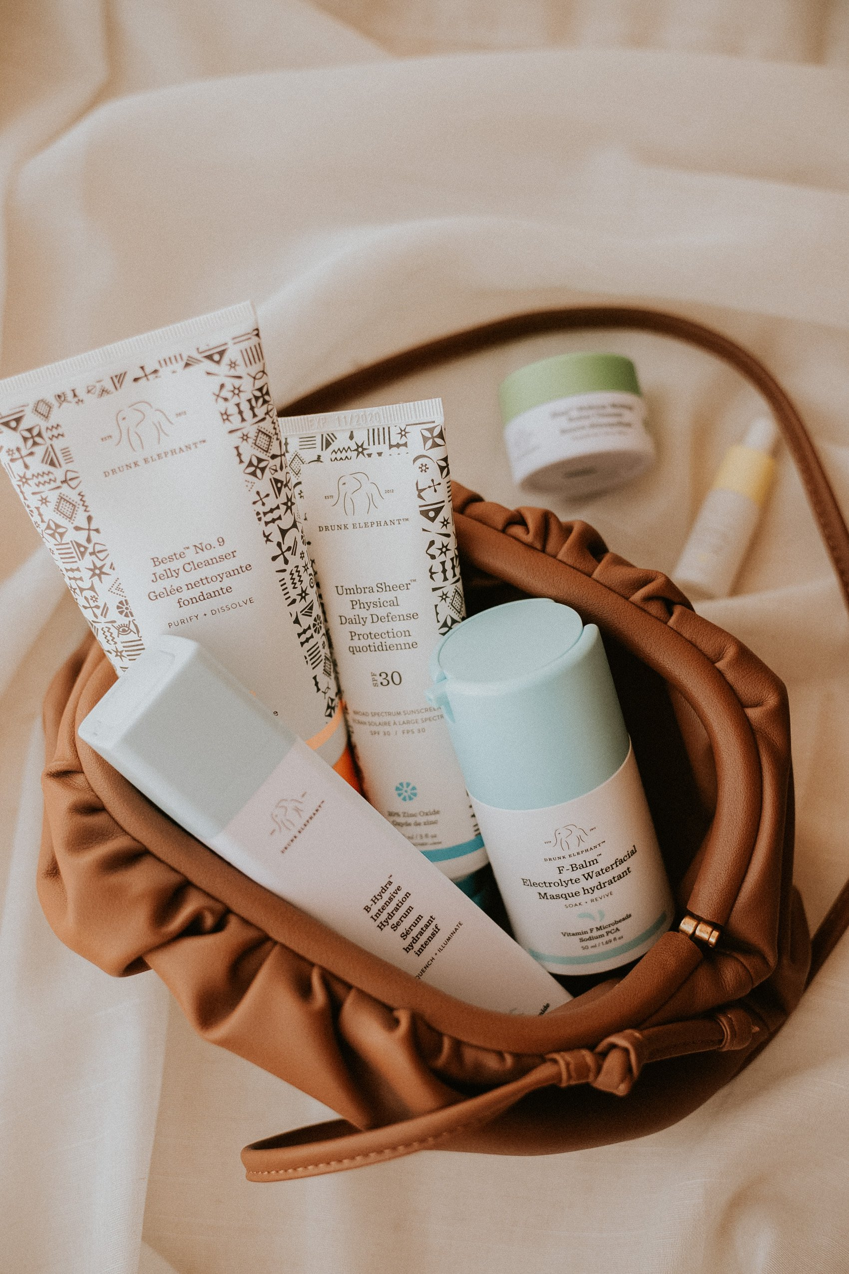 Drunk Elephant Winter Skincare Products in a Makeup Bag