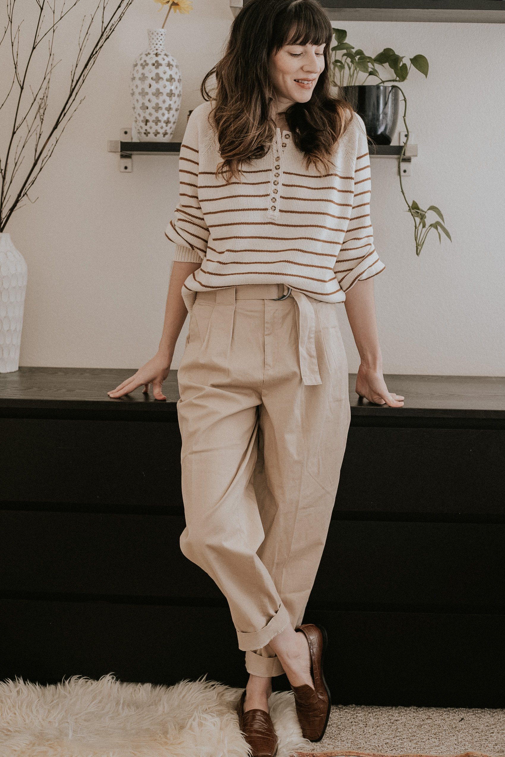 Woman wearing Sezane Leontine Jumper, Banana Republic Pants, Everlane Loafers