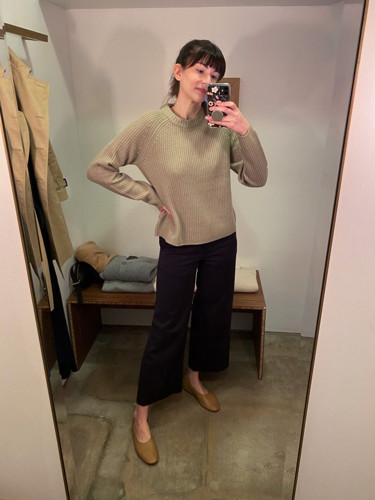 Cashmere Fisherman Sweater in Sage at the Brentwood Country Mart fitting room