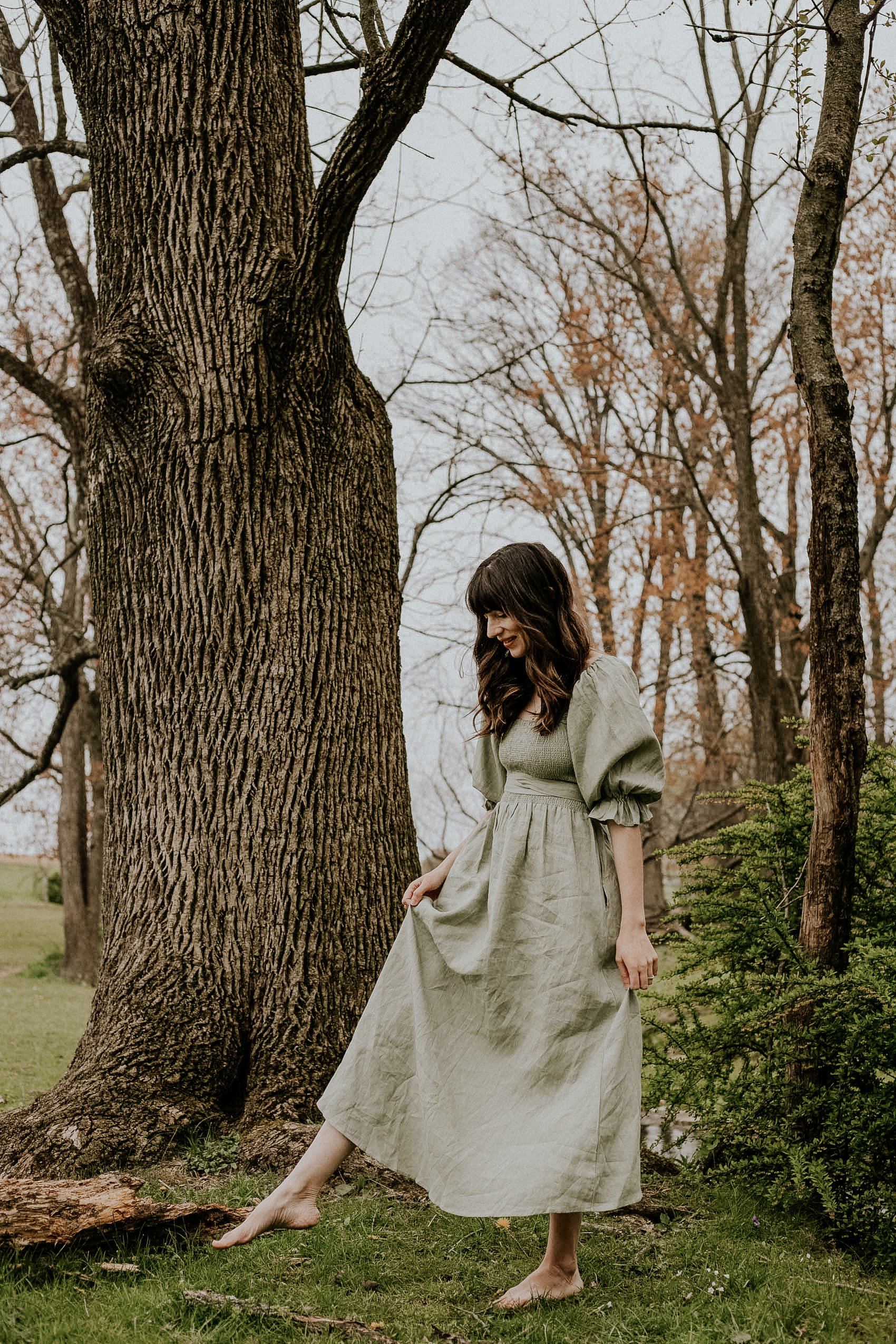 Reversible Linen Dress from Aulieude on woman barefoot in the woods