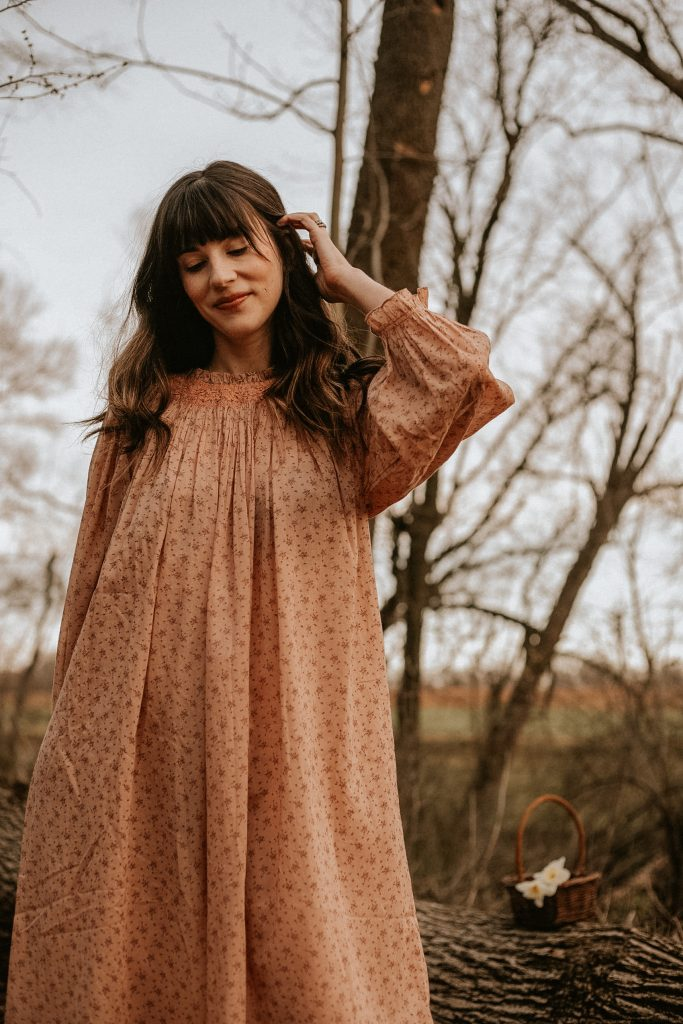 A light pink floral nightgown in cotton voile from DOEN on woman in the woods