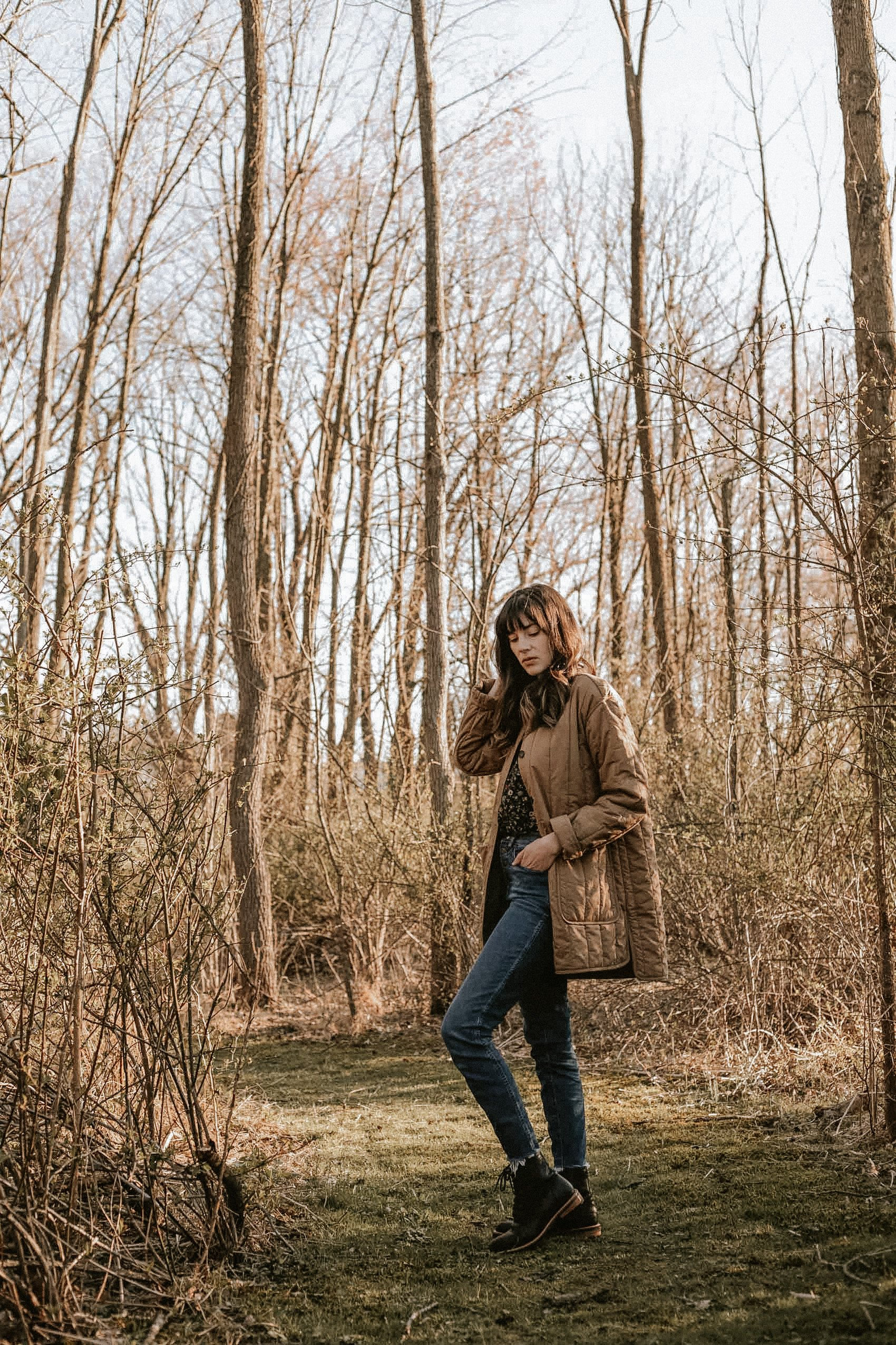 Everlane Cotton Quilted Jacket with Everlane Denim and Nisolo Boots on Fashion Blogger standing in the woods