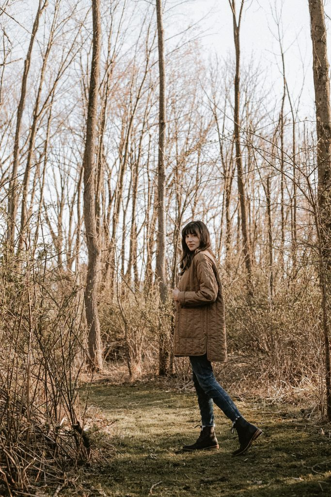A cotton liner jacket and Nisolo boots on Lancaster Pennsylvania Blogger in the woods