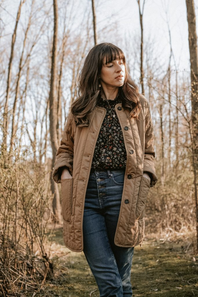 Everlane Quilted Cotton Liner Jacket with a Doen Blouse on Lancaster County Blogger in the woods
