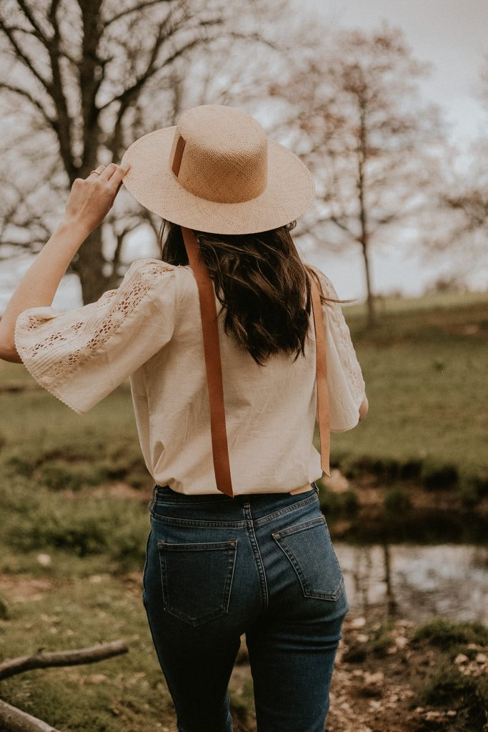 Janessa Leone Agnes Straw Hat with Leather Ties on Lancaster County Fashion Blogger in a field