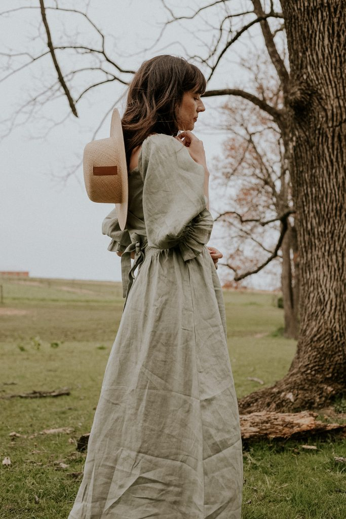 Linen Puff Sleeve Dress with Straw Hat on Woman in field