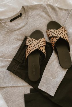 Jenni Kayne flatlay with Crosby Sweater, Twill Pants, Crossover sandals