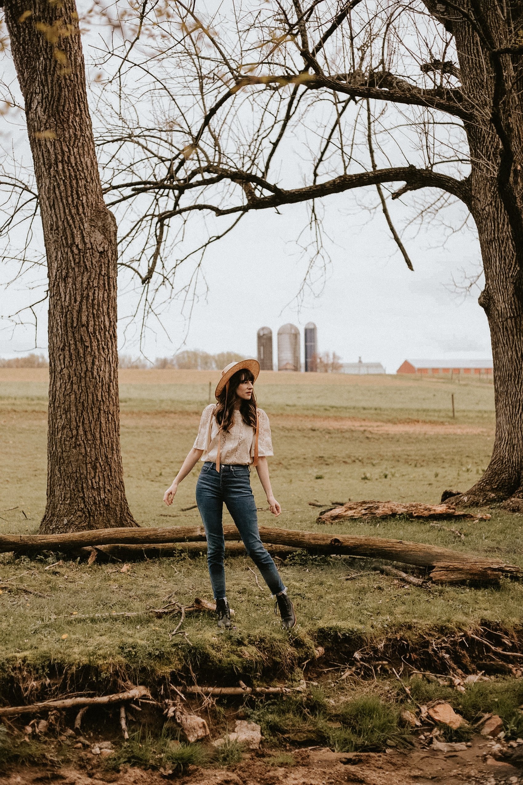 Sezane Blouse with Everlane Jeans and Nisolo Boots on women in field