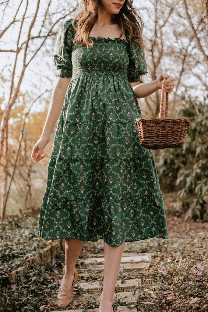 Smocked cottagecore dress with tiered skirt from Hill House Home on woman with basket in woods