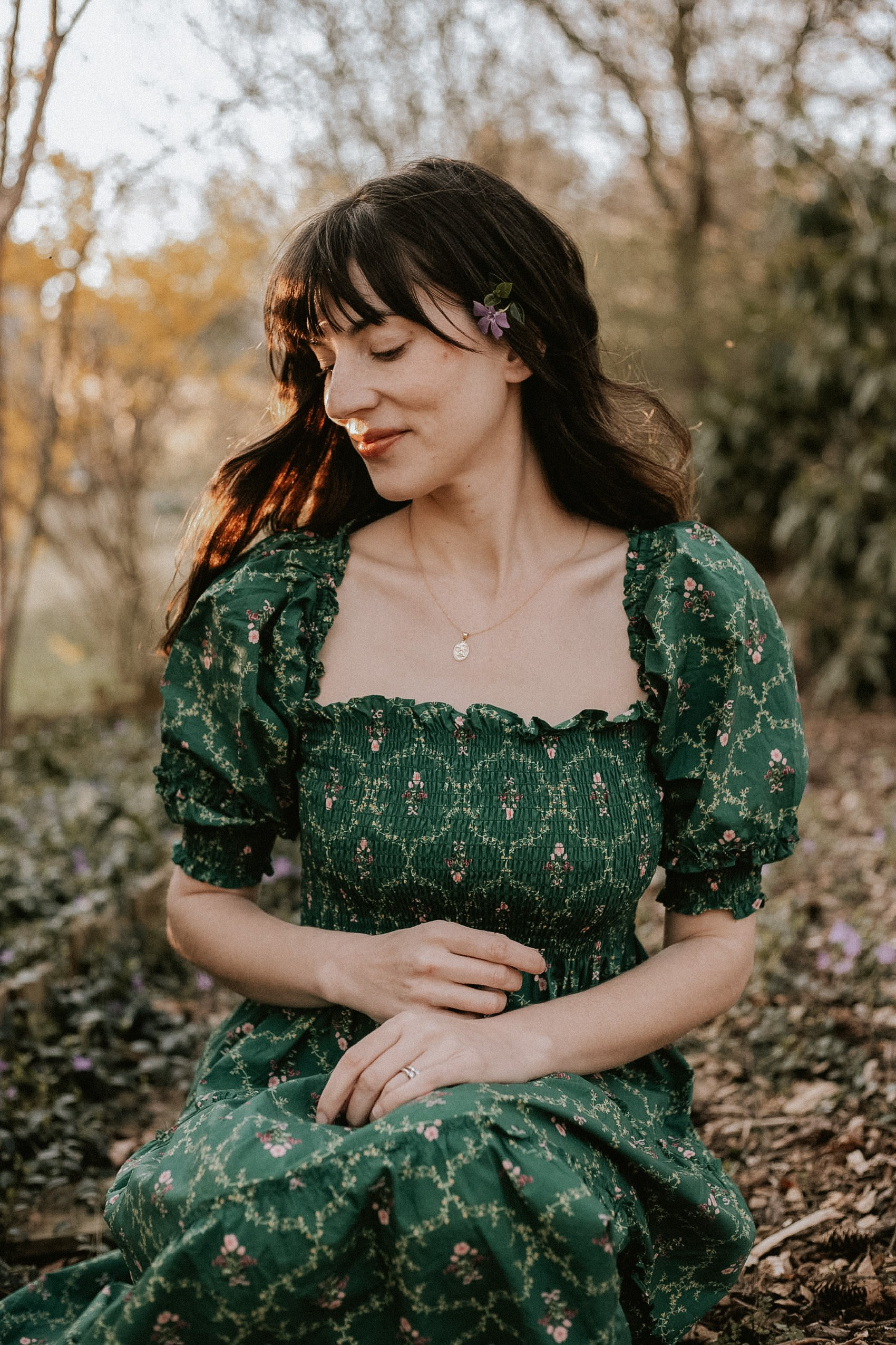 Square Neck Smocked cottagecore dress on woman sitting in the woods