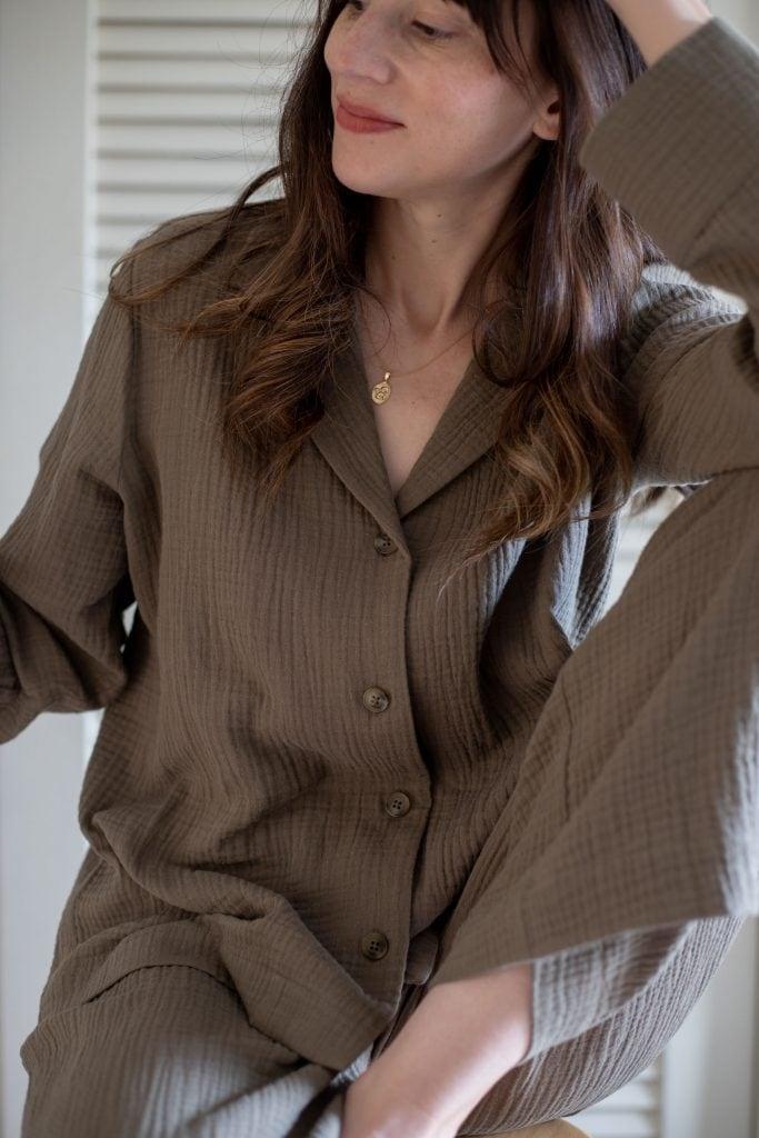 Jenni Kayne Playa Pajamas in Sage on woman sitting on stool