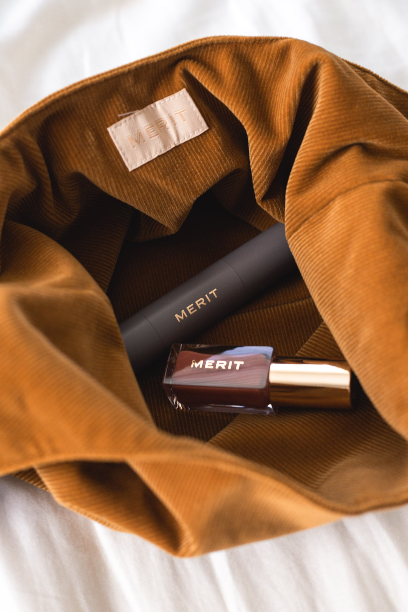 Merit Beauty Bag with Perfecting Complexion Foundation and Tinted Lip Oil