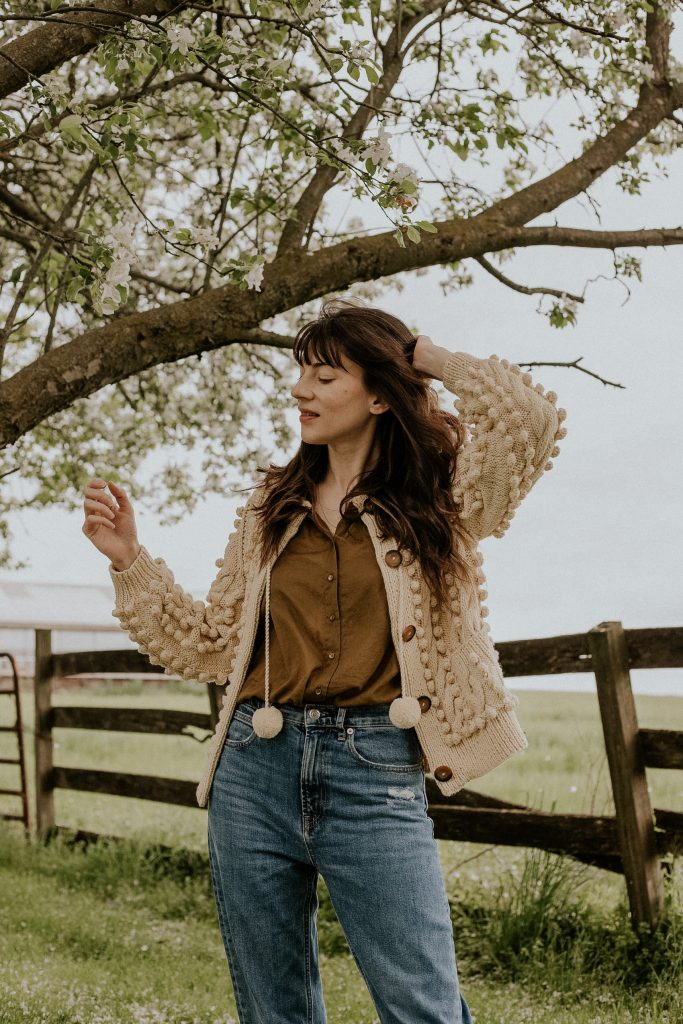 Doen Pomme Cardigan Sweater with The Jane Blouse and Everlane High Waisted Denim on woman in field