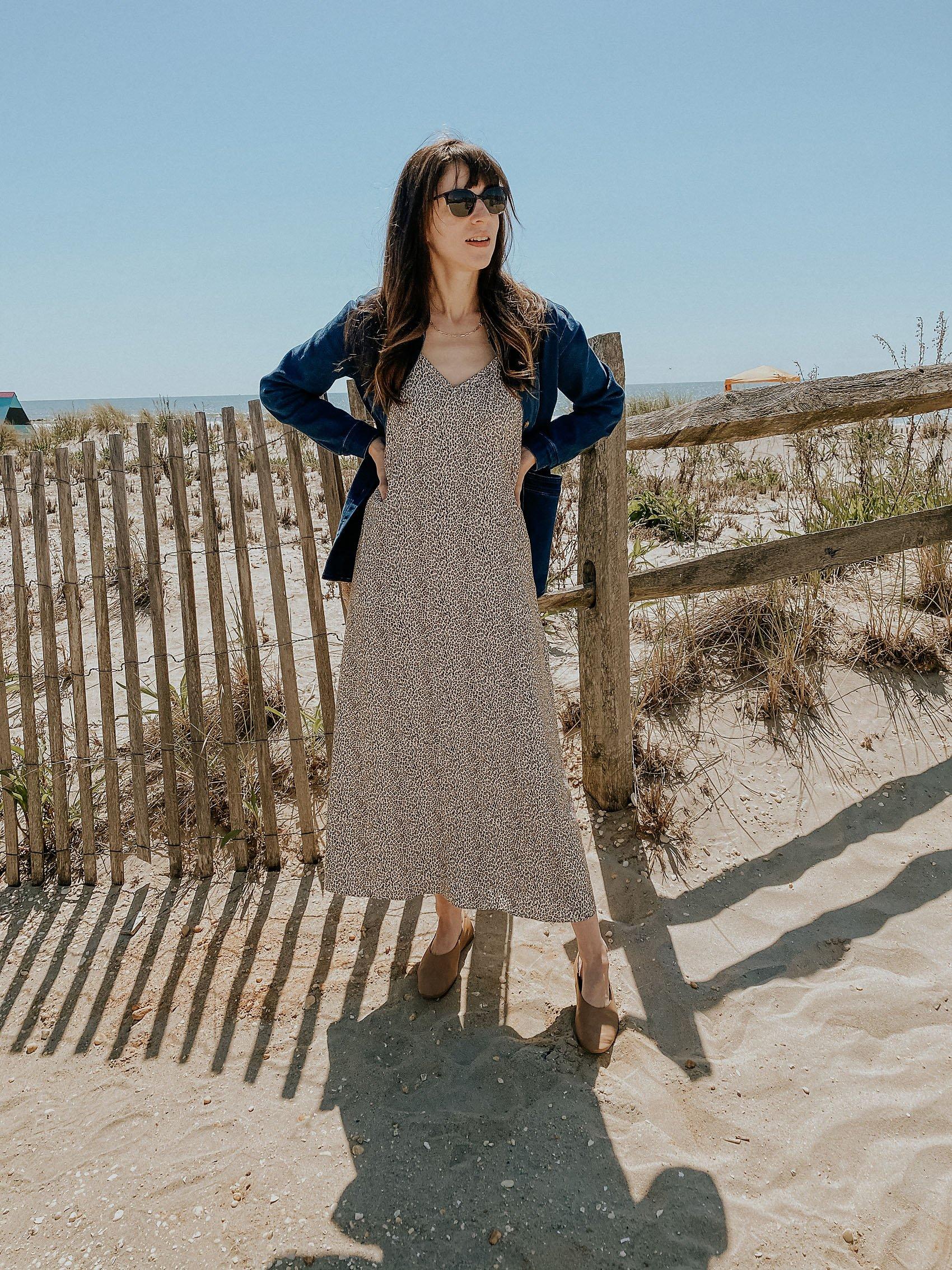 Jenni Kayne Leopard Slip dress on woman standing on the beach