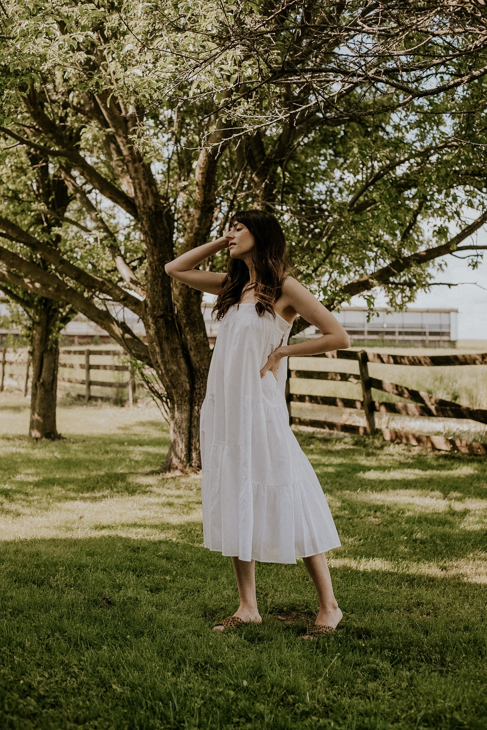 White Cotton/Linen Summer Dress with Cheetah print sandals on woman standing in field