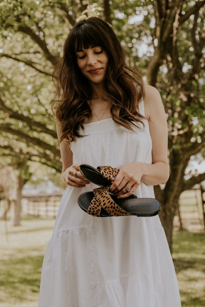 Jenni Kayne Pony Hair Crossover Sandals in Cheetah with white summer dress