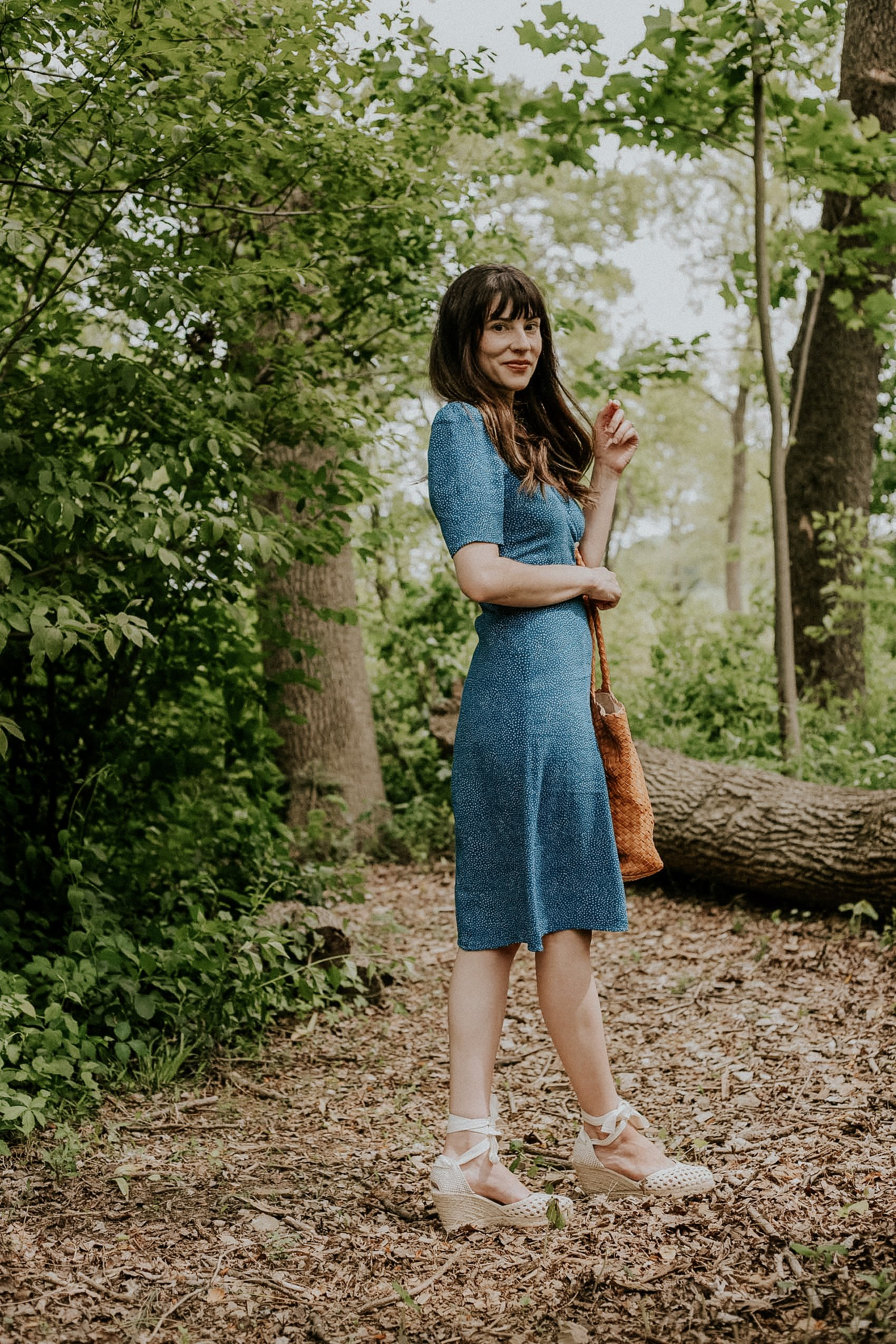 Rouje Gabin summer dress with Sezane Espadrilles and Milaner Bag on woman in the woods