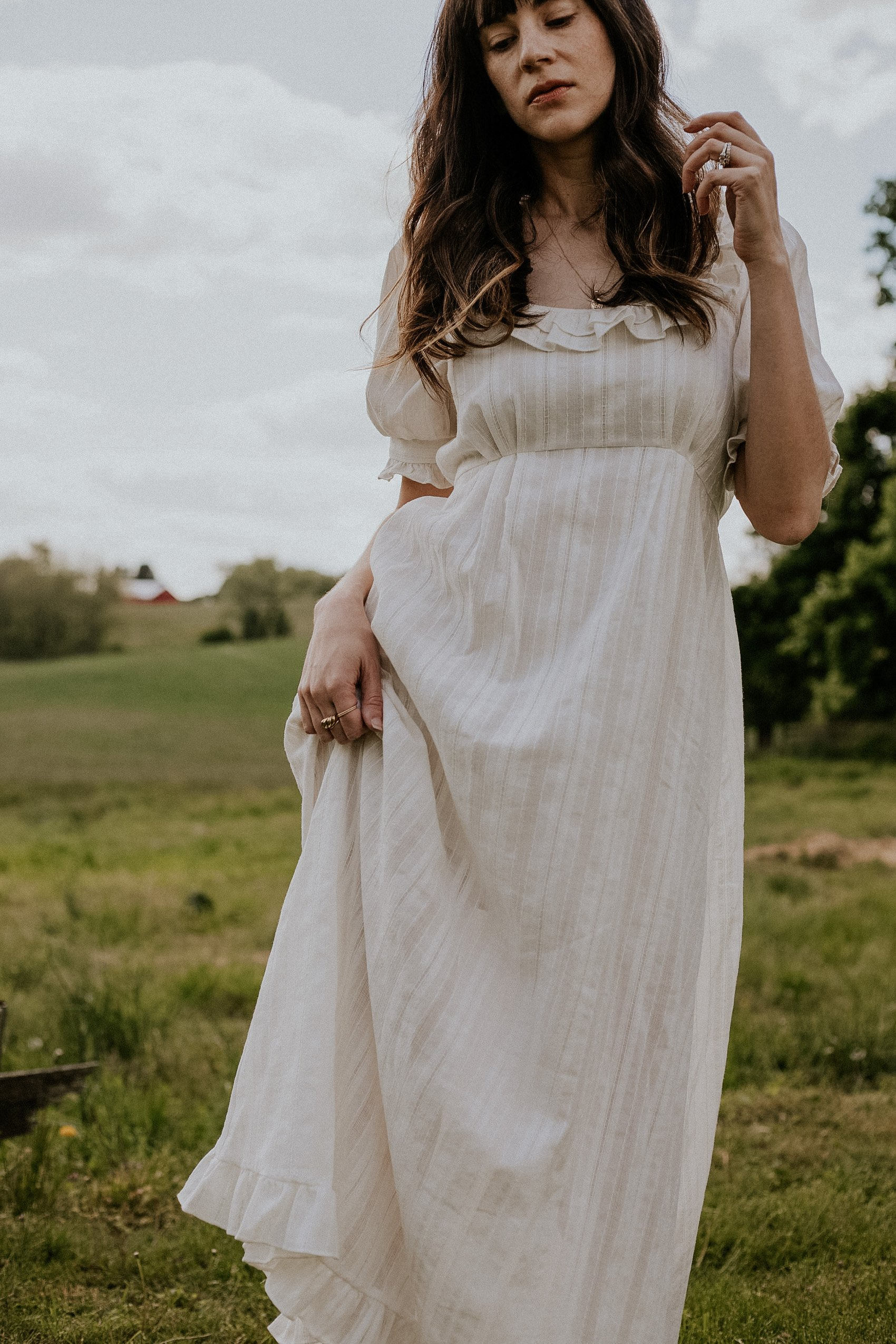 White Cottagecore Summer Dress from Christy Dawn on woman in field