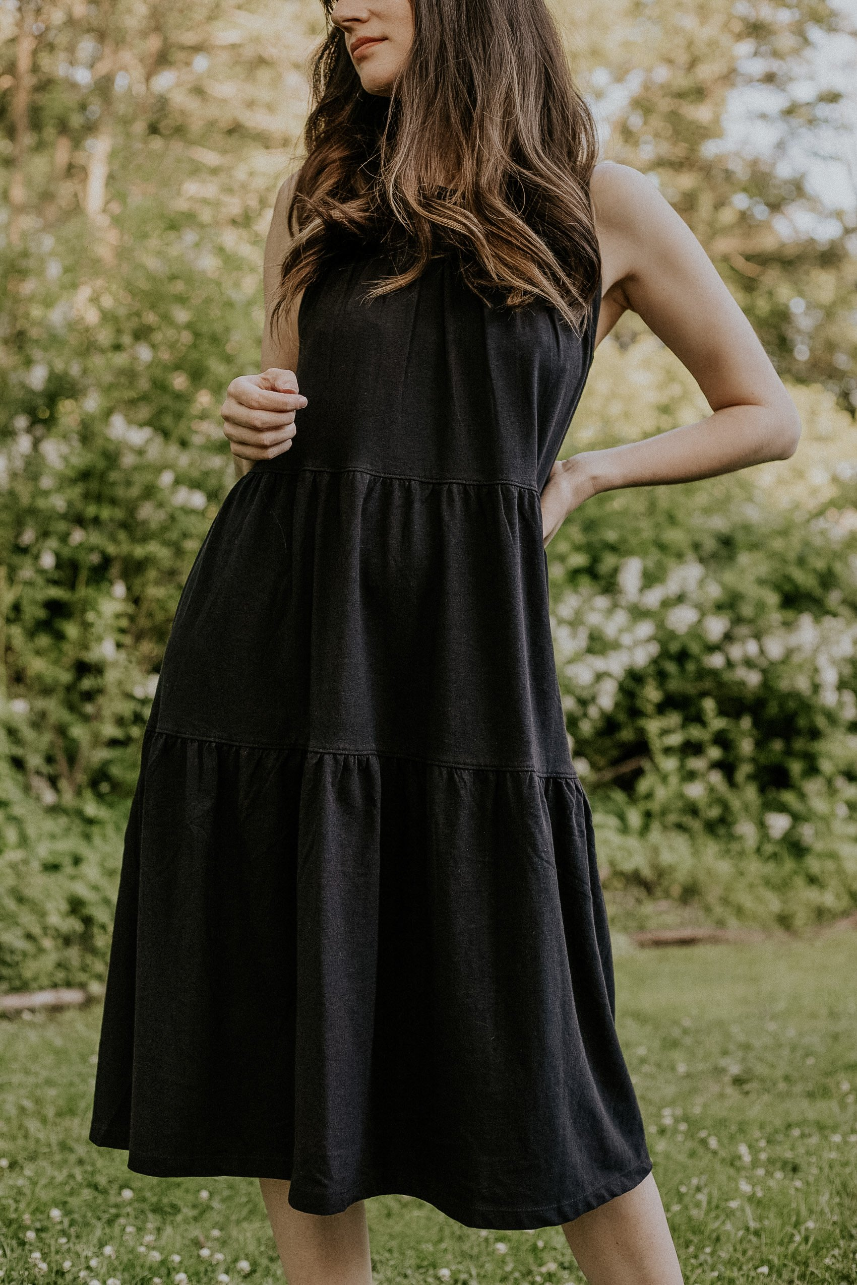 Black Sleeveless Tiered T-Shirt Dress from Everlane on woman standing in field