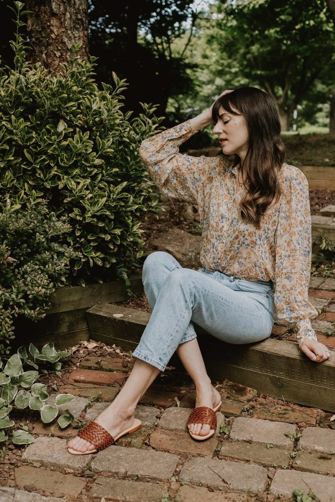 Nisolo Isla Slides with Sezane floral blouse and Everlane denim
