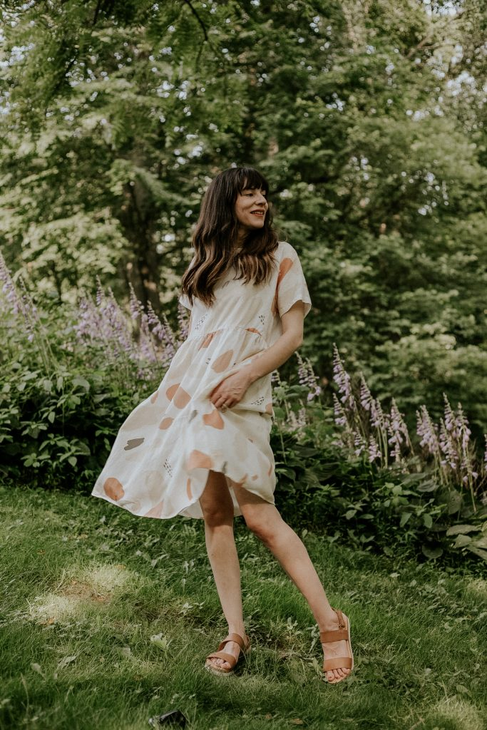 Linen Tent Dress with Flatform Sandals on woman standing in the grass